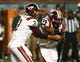 Nov 9, 2013; Miami Gardens, FL, USA; Virginia Tech Hokies quarterback Logan Thomas (3) fakes a handoff to running back Trey Edmunds (14) in the first quarter of a game against the Miami Hurricanes at Sun Life Stadium. Mandatory Credit: Robert Mayer-USA TODAY Sports