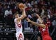 Nov 9, 2013; Houston, TX, USA; Houston Rockets small forward Chandler Parsons (25) shoots during the third quarter as Los Angeles Clippers small forward Jared Dudley (9) defends at Toyota Center. Mandatory Credit: Troy Taormina-USA TODAY Sports