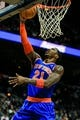 Nov 13, 2013; Atlanta, GA, USA; New York Knicks shooting guard Iman Shumpert (21) shoots a basket in the first quarter against the Atlanta Hawks at Philips Arena. Mandatory Credit: Daniel Shirey-USA TODAY Sports