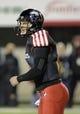 Nov 13, 2013; DeKalb, IL, USA;  Northern Illinois Huskies quarterback Jordan Lynch (6) yells during the 1st quarter against the Ball State Cardinals at Huskie Stadium. Mandatory Credit: Matt Marton-USA TODAY Sports