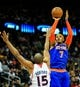 Nov 13, 2013; Atlanta, GA, USA; New York Knicks small forward Carmelo Anthony (7) shoots a basket over Atlanta Hawks center Al Horford (15) in the first half at Philips Arena. Mandatory Credit: Daniel Shirey-USA TODAY Sports