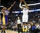 Nov 13, 2013; Denver, CO, USA; Denver Nuggets guard Randy Foye (4) shoots a three point shot over Los Angeles Lakers guard Jodie Meeks (20) during the first quarter at Pepsi Center. Mandatory Credit: Chris Humphreys-USA TODAY Sports