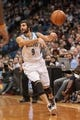 Nov 13, 2013; Minneapolis, MN, USA; Minnesota Timberwolves point guard Ricky Rubio (9) passes in the third quarter against the Cleveland Cavaliers at Target Center. The Minnesota Timberwolves win 124-95. Mandatory Credit: Brad Rempel-USA TODAY Sports