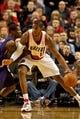 Nov 13, 2013; Portland, OR, USA; Portland Trail Blazers power forward LaMarcus Aldridge (12) posts up against Phoenix Suns point guard Eric Bledsoe (2) at the Moda Center. Mandatory Credit: Craig Mitchelldyer-USA TODAY Sports