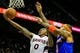 Nov 13, 2013; Atlanta, GA, USA; Atlanta Hawks point guard Jeff Teague (0) shoots a basket past New York Knicks power forward Kenyon Martin (3) in the second half at Philips Arena. The Knicks won 95-91. Mandatory Credit: Daniel Shirey-USA TODAY Sports