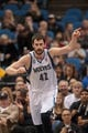 Nov 13, 2013; Minneapolis, MN, USA; Minnesota Timberwolves power forward Kevin Love (42) points to the crowd in the third quarter against the Cleveland Cavaliers at Target Center. Mandatory Credit: Brad Rempel-USA TODAY Sports.