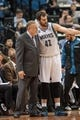 Nov 13, 2013; Minneapolis, MN, USA; Minnesota Timberwolves power forward Kevin Love (42) and head coach Rick Adelman talk in the third quarter against the Cleveland Cavaliers at Target Center. The Minnesota Timberwolves win 124-95. Mandatory Credit: Brad Rempel-USA TODAY Sports.