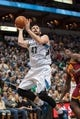 Nov 13, 2013; Minneapolis, MN, USA; Minnesota Timberwolves power forward Kevin Love (42) shoots in the third quarter against the Cleveland Cavaliers at Target Center. Mandatory Credit: Brad Rempel-USA TODAY Sports. The Minnesota Timberwolves win 124-95.