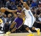 Nov 13, 2013; Denver, CO, USA;  Los Angeles Lakers forward Nick Young (0) drives to the basket during the second half against the  Denver Nuggets at Pepsi Center.  The Nuggets won 111-99.  Mandatory Credit: Chris Humphreys-USA TODAY Sports