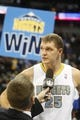 Nov 13, 2013; Denver, CO, USA;  Denver Nuggets center Timofey Mozgov (25) is interviewed after the game against the Los Angeles Lakers at Pepsi Center.  The Nuggets won 111-99.  Mandatory Credit: Chris Humphreys-USA TODAY Sports