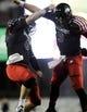Nov 13, 2013; DeKalb, IL, USA;  Northern Illinois Cardinals quarterback Jordan Lynch (6) and quarterback Matt McIntosh (9) celebrate after scoring a touchdown in the 4th quarter against Ball State Huskies at Huskie Stadium. Mandatory Credit: Matt Marton-USA TODAY Sports