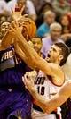 Nov 13, 2013; Portland, OR, USA; Portland Trail Blazers center Joel Freeland (19) and Phoenix Suns shooting guard Gerald Green (14) fight for a rebound at the Moda Center. Mandatory Credit: Craig Mitchelldyer-USA TODAY Sports