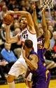 Nov 13, 2013; Portland, OR, USA; Portland Trail Blazers center Robin Lopez (42) shoots over Phoenix Suns power forward Markieff Morris (11) at the Moda Center. Mandatory Credit: Craig Mitchelldyer-USA TODAY Sports