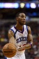 Nov 11, 2013; Philadelphia, PA, USA; Philadelphia 76ers guard Evan Turner (12) passes the ball during the first quarter against the San Antonio Spurs at Wells Fargo Center. The Spurs defeated the Sixers 109-85. Mandatory Credit: Howard Smith-USA TODAY Sports