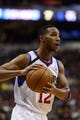 Nov 11, 2013; Philadelphia, PA, USA; Philadelphia 76ers guard Evan Turner (12) looks to pass during the first quarter against the San Antonio Spurs at Wells Fargo Center. The Spurs defeated the Sixers 109-85. Mandatory Credit: Howard Smith-USA TODAY Sports