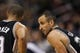 Nov 11, 2013; Philadelphia, PA, USA; San Antonio Spurs guard Manu Ginobili (20) talks with guard Tony Parker (9) during the first quarter against the Philadelphia 76ers at Wells Fargo Center. The Spurs defeated the Sixers 109-85. Mandatory Credit: Howard Smith-USA TODAY Sports