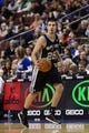 Nov 11, 2013; Philadelphia, PA, USA; San Antonio Spurs guard Nando De Colo (25) brings the ball up court during the fourth quarter against the Philadelphia 76ers at Wells Fargo Center. The Spurs defeated the Sixers 109-85. Mandatory Credit: Howard Smith-USA TODAY Sports
