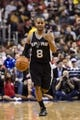 Nov 11, 2013; Philadelphia, PA, USA; San Antonio Spurs guard Patty Mills (8) brings the ball up court during the third quarter against the Philadelphia 76ers at Wells Fargo Center. The Spurs defeated the Sixers 109-85. Mandatory Credit: Howard Smith-USA TODAY Sports