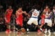 Nov 14, 2013; New York, NY, USA; Houston Rockets point guard Jeremy Lin (7) and New York Knicks shooting guard Iman Shumpert (21) fight for a loose ball during the fourth quarter of a game at Madison Square Garden. The Rockets beat the Knicks 109-106. Mandatory Credit: Brad Penner-USA TODAY Sports