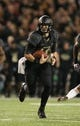 Nov 7, 2013; Waco, TX, USA; Baylor Bears quarterback Bryce Petty (14) scrambles with the ball against the Oklahoma Sooners at Floyd Casey Stadium. Mandatory Credit: Matthew Emmons-USA TODAY Sports