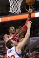 Nov 13, 2013; Philadelphia, PA, USA; Houston Rockets forward Dwight Howard (12) shoots under pressure from Philadelphia 76ers center Spencer Hawes (00) during the second quarter at Wells Fargo Center. The Sixers defeated the Rockets 123-117. Mandatory Credit: Howard Smith-USA TODAY Sports