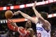 Nov 13, 2013; Philadelphia, PA, USA; Houston Rockets forward Dwight Howard (12) shoots under pressure from Philadelphia 76ers center Spencer Hawes (00) during overtime at Wells Fargo Center. The Sixers defeated the Rockets 123-117. Mandatory Credit: Howard Smith-USA TODAY Sports