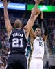 Nov 15, 2013; Salt Lake City, UT, USA; Utah Jazz power forward Derrick Favors (15) shoots while defended by San Antonio Spurs power forward Tim Duncan (21) during the first half at EnergySolutions Arena. Mandatory Credit: Russ Isabella-USA TODAY Sports