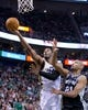 Nov 15, 2013; Salt Lake City, UT, USA; Utah Jazz power forward Derrick Favors (15) goes to the basket in front of San Antonio Spurs power forward Tim Duncan (21) during the first half at EnergySolutions Arena. Mandatory Credit: Russ Isabella-USA TODAY Sports