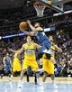 Nov 15, 2013; Denver, CO, USA; Minnesota Timberwolves point guard J.J. Barea (11) takes a shot against Denver Nuggets center Timofey Mozgov (25) and shooting guard Evan Fournier (94) in the third quarter at the Pepsi Center. The Nuggets won 117-113. Mandatory Credit: Isaiah J. Downing-USA TODAY Sports