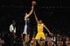 Nov 15, 2013; Los Angeles, CA, USA; Memphis Grizzlies forward Tayshaun Prince (21) attempts a shot defended by Los Angeles Lakers guard Wesley Johnson (11) during the third quarter at Staples Center. The Memphis Grizzlies defeated the Los Angeles Lakers 89-86. Mandatory Credit: Kelvin Kuo-USA TODAY Sports