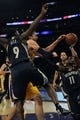 Nov 15, 2013; Los Angeles, CA, USA; Los Angeles Lakers center Pau Gasol (16) is fouled while attempting to move the ball defended by Memphis Grizzlies guard Tony Allen (9) during the third quarter at Staples Center. The Memphis Grizzlies defeated the Los Angeles Lakers 89-86. Mandatory Credit: Kelvin Kuo-USA TODAY Sports