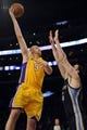 Nov 15, 2013; Los Angeles, CA, USA; Los Angeles Lakers center Chris Kaman (9) goes up for a shot defended by Memphis Grizzlies center Kosta Koufos (42) during the third quarter at Staples Center. The Memphis Grizzlies defeated the Los Angeles Lakers 89-86. Mandatory Credit: Kelvin Kuo-USA TODAY Sports