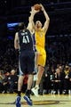 Nov 15, 2013; Los Angeles, CA, USA; Los Angeles Lakers center Chris Kaman (9) goes up for a shot defended by Memphis Grizzlies center Kosta Koufos (42) during the fourth quarter at Staples Center. The Memphis Grizzlies defeated the Los Angeles Lakers 89-86. Mandatory Credit: Kelvin Kuo-USA TODAY Sports