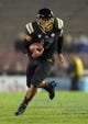 Nov 15, 2013; Pasadena, CA, USA; UCLA Bruins quarterback Brett Hundley (17) scrambles during the game against the Washington Huskies at Rose Bowl. UCLA defeated Washington 41-31.  Mandatory Credit: Kirby Lee-USA TODAY Sports