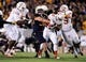 Nov 9, 2013; Morgantown, WV, USA; Texas Longhorns running back Johnathan Gray (32) gets tackled by West Virginia Mountaineers linebacker Nick Kwiatkoski (35) at Milan Puskar Stadium. Mandatory Credit: Evan Habeeb-USA TODAY Sports