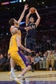 Nov 12, 2013; Los Angeles, CA, USA; New Orleans Pelicans center Jason Smith (14) is defended by Los Angeles Lakers forward Pau Gasol (16) at Staples Center. The Lakers defeated the Pelicans 116-95. Mandatory Credit: Kirby Lee-USA TODAY Sports