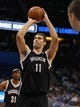 Nov 3, 2013; Orlando, FL, USA; Brooklyn Nets center Brook Lopez (11) shoots a free throw against the Orlando Magic during the second quarter at Amway Center. Mandatory Credit: Kim Klement-USA TODAY Sports
