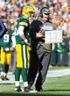 Nov 10, 2013; Green Bay, WI, USA; Green Bay Packers quarterback Scott Tolzien (16) talks with head coach Mike McCarthy during the game against the Philadelphia Eagles at Lambeau Field.  Philadelphia won 27-13.  Mandatory Credit: Jeff Hanisch-USA TODAY Sports