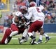 Nov 16, 2013; Oxford, MS, USA; Mississippi Rebels running back Jaylen Walton (6) is tackled by Troy Trojans safety Chris Pickett (7) during the first half at Vaught-Hemingway Stadium. Mandatory Credit: Justin Ford-USA TODAY Sports
