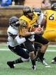 Nov 16, 2013; Hattiesburg, MS, USA; Southern Miss Golden Eagles quarterback Nick Mullens (14) is sacked by Florida Atlantic Owls safety Damian Parms (17) during the first half at M.M. Roberts Stadium. Mandatory Credit: Chuck Cook-USA TODAY Sports