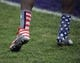 Nov 16, 2013; Evanston, IL, USA;  A detail shot of Northwestern Wildcats shoes as they wear the wounded warrior project uniforms before the game against the Michigan Wolverines at Ryan Field. Mandatory Credit: David Banks-USA TODAY Sports