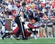 Nov 16, 2013; Oxford, MS, USA; Mississippi Rebels quarterback Barry Brunetti (11) is tackled by a Troy Trojans during the third quarter at Vaught-Hemingway Stadium. Mississippi Rebels beat the Troy Trojans 51-21. Mandatory Credit: Justin Ford-USA TODAY Sports