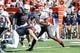 Nov 16, 2013; Tucson, AZ, USA; Washington State Cougars wide receiver Kristoff Williams (18) runs the ball as he is tackled by Arizona Wildcats linebacker Jake Fischer (33) during the second quarter at Arizona Stadium. Mandatory Credit: Casey Sapio-USA TODAY Sports