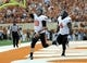 Nov 16, 2013; Austin, TX, USA; Oklahoma State Cowboys quarterback Clint Chelf (10) and fulback Desmond Roland (9) celebrate after a touchdown against the Texas Longhorns during the first quarter at Darrell K Royal-Texas Memorial Stadium. Mandatory Credit: Brendan Maloney-USA TODAY Sports