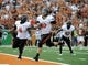 Nov 16, 2013; Austin, TX, USA; Oklahoma State Cowboys quarterback Clint Chelf (10) scores a touchdown against the Texas Longhorns during the first quarter at Darrell K Royal-Texas Memorial Stadium. Mandatory Credit: Brendan Maloney-USA TODAY Sports