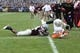 Nov 16, 2013; Blacksburg, VA, USA; Maryland Terrapins quarterback C.J. Brown (16) scores a touchdown in overtime as Virginia Tech Hokies linebacker Tariq Edwards (24) defends. The Terapins defeated the Virginia Tech Hokies 27-24 at Lane Stadium. Mandatory Credit: Bob Donnan-USA TODAY Sports