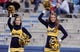 Nov 16, 2013; Lawrence, KS, USA; West Virginia Mountaineers cheerleaders perform after a score against the Kansas Jayhawks in the second half at Memorial Stadium. Kansas won the game 31-19. Mandatory Credit: John Rieger-USA TODAY Sports