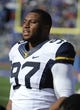 Nov 16, 2013; Lawrence, KS, USA; West Virginia Mountaineers defensive lineman Noble Nwachukwu (97) on the sidelines against the Kansas Jayhawks in the second half at Memorial Stadium. Kansas won the game 31-19. Mandatory Credit: John Rieger-USA TODAY Sports