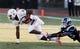 Nov 16, 2013; Durham, NC, USA; Miami Hurricanes wide receiver Herb Waters (6) escapes the grasp of Duke Blue Devils cornerback Deondre Singleton (33) at Wallace Wade Stadium. Mandatory Credit: Mark Dolejs-USA TODAY Sports