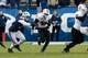 Nov 16, 2013; Provo, UT, USA; Idaho State Bengals running back Aaron Prier (20) runs past Brigham Young Cougars linebacker Sae Tautu (31) during the fourth quarter at Lavell Edwards Stadium. BYU won 59-13. Mandatory Credit: Chris Nicoll-USA TODAY Sports.